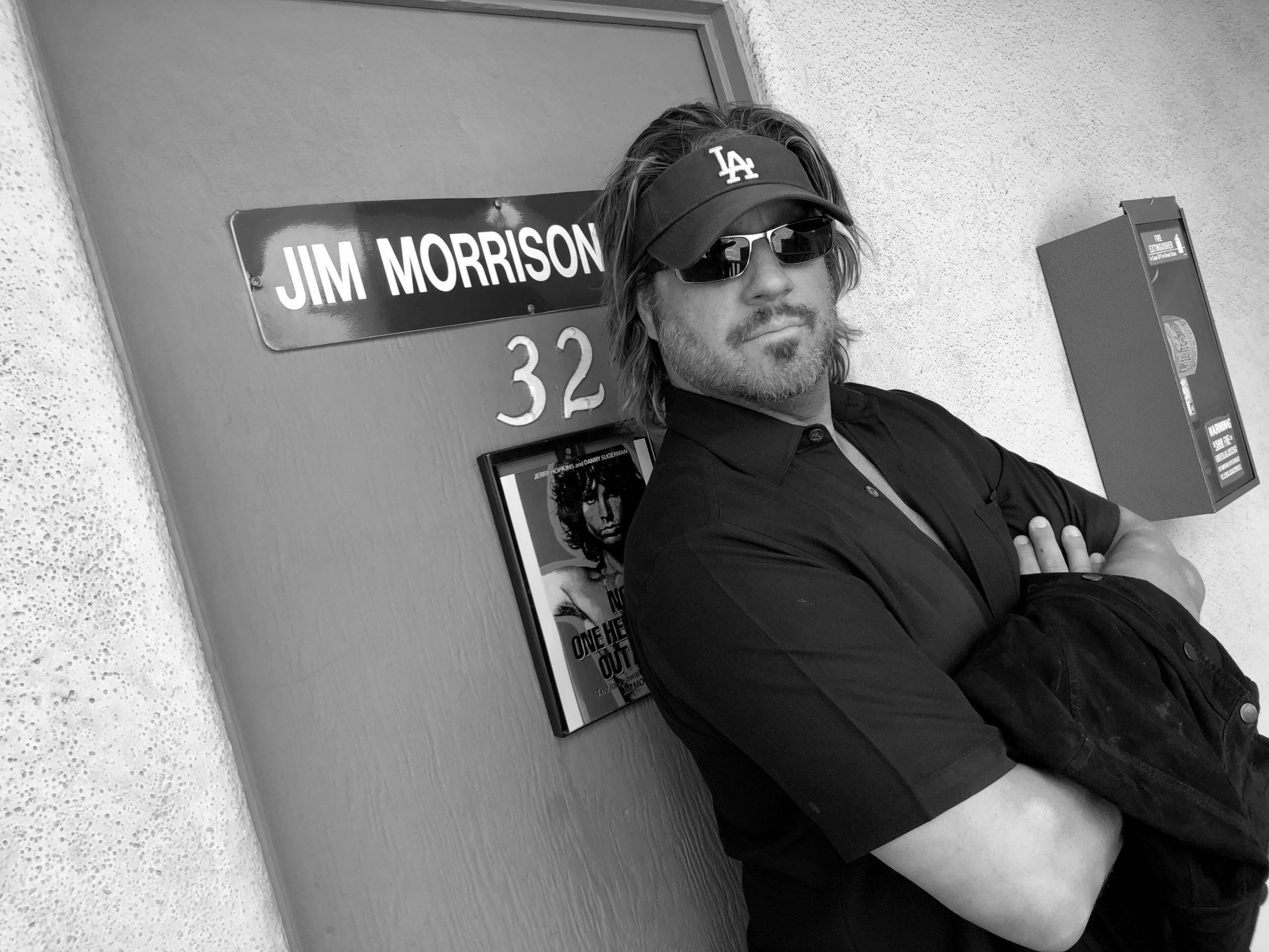 Jon Doscher in front of Jim Morrison sign