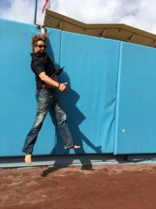 Jon Doscher barefoot baseball field enacting catching fly ball